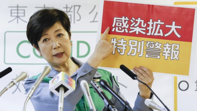 July 31, 2020, Tokyo, Japan: Tokyo Governor Yuriko Koike points out a placard written in Japanese with the phrase a spe