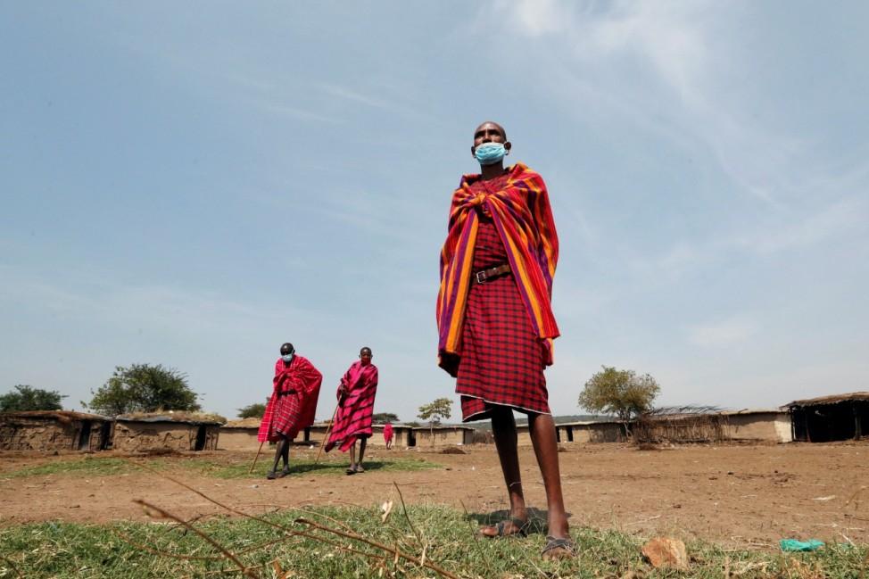 Maasai elders gather at their homestead within the Orboma Manyatta in Sekenani near the Maasai Mara game reserve in Narok County