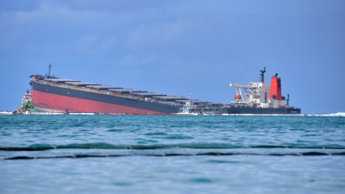 A general view shows the bulk carrier ship MV Wakashio, belonging to a Japanese company but Panamanian-flagged, that ran aground on a reef, at Riviere des Creoles