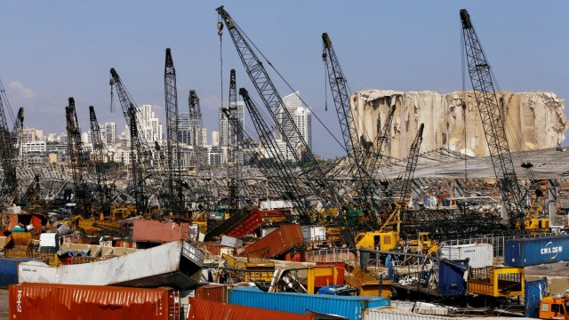Debris and damaged vehicles are seen in the port area, after a blast in Beirut