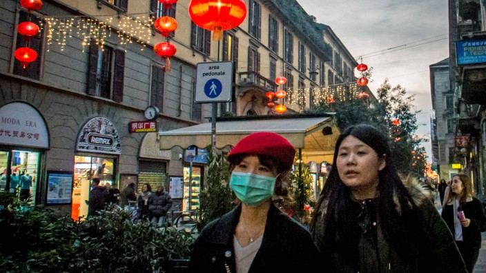 People in the street with masks in China Town in Via Paolo Sarpi alarm for Wuhan virus in view of the Chinese New Year (