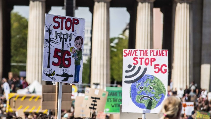 September 20, 2019, Munich, Bavaria, Germany: Anti-5G conspiracy signs on display during a climate march in Munich, Germ