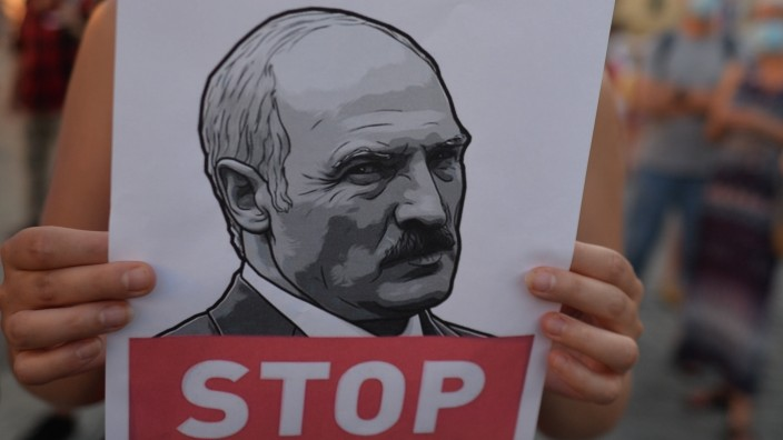 August 12, 2020, Krakow, Poland: A protester holding an image of Alexander Lukashenko who has served as President of Be