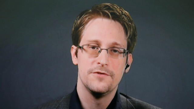 FILE PHOTO: Edward Snowden speaks via video link during a news conference in New York