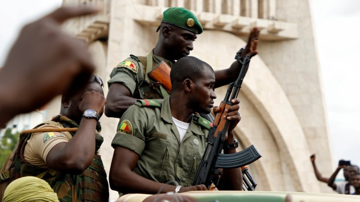 Malian army soldiers are seen at the Independence Square after a mutiny, in Bamako