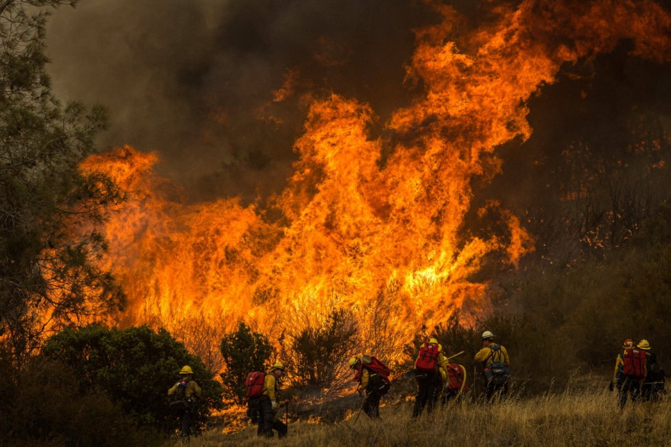 August 20, 2020, Mocassin, California, USA: A helicopter drops water on the MocFire as it burns near San Francisco s Het