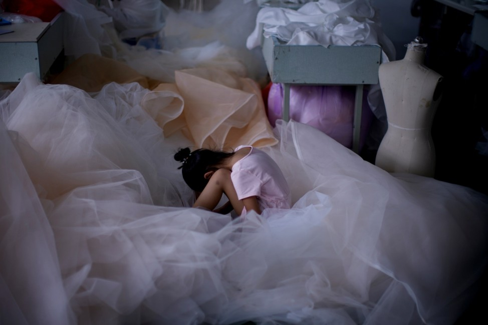 The Wider Image: Coronavirus dampens celebrations in China's wedding gown city