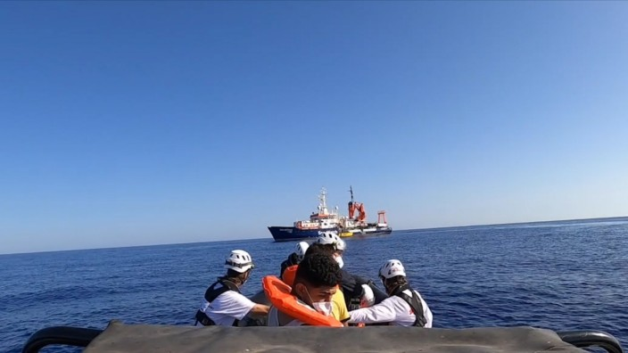 A rescue team with migrants heads to the Sea-Watch 4 ship on board of rubber dinghy, at sea off the coast of Libya