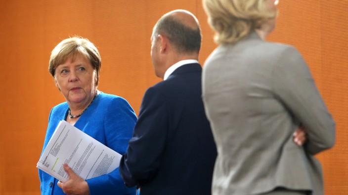 Angela Merkel und Olaf Scholz bei einer Kabinettssitzung