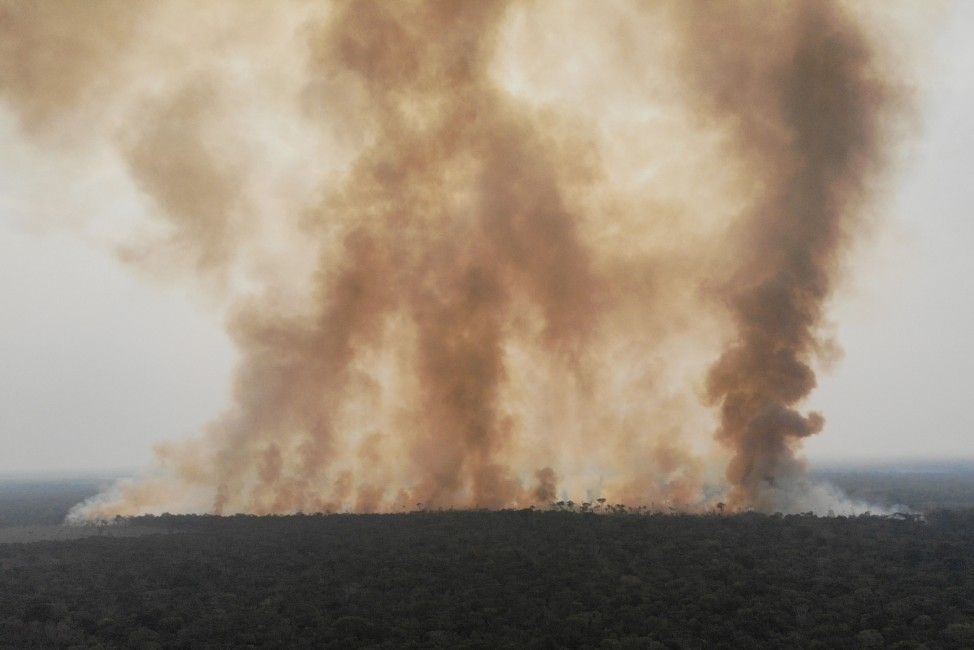 Smoke billows from a fire in an area of the Amazon jungle as it is cleared by loggers and farmers near Humaita
