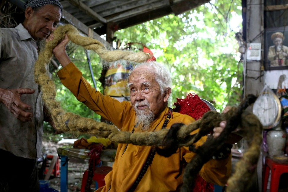 A 92-year-old man shows his five-meter long hair in Vietnam