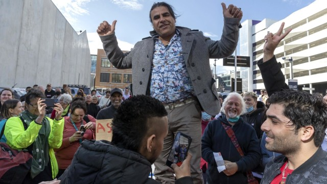 BRENTON TARRANT SENTENCING CHRISTCHURCH, Survivor Abdul Aziz Wahabzadah celebrates with supporters outside the High Cou