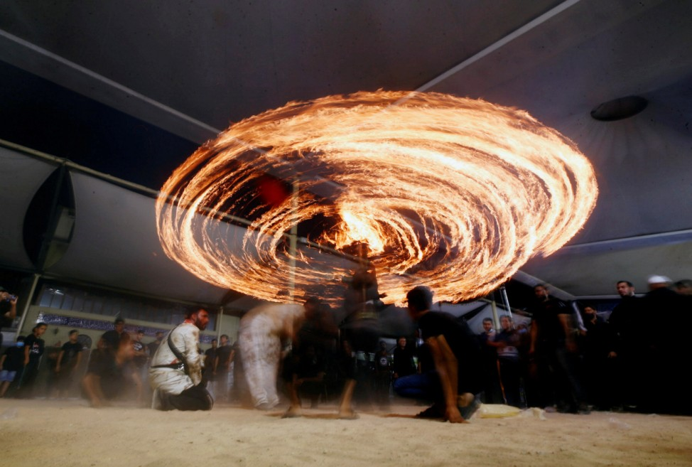 Shi'ite Muslims perform with fire during commemorations of Ashura, amid the spread of the coronavirus disease (COVID-19), in the holy city of Najaf