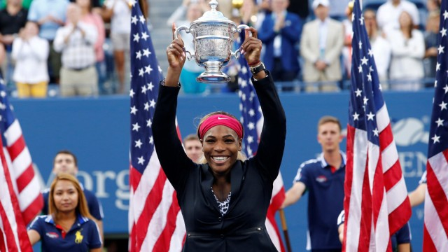 FILE PHOTO: Williams of the U.S. raises her trophy after defeating Wozniacki of Denmark in their women's singles finals match at the 2014 U.S. Open tennis tournament in New York