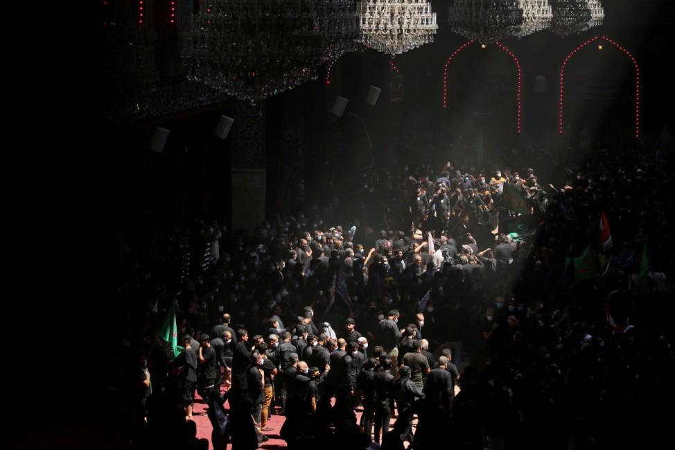 Shi'ite Muslim pilgrims gather to commemorate Ashura amid COVID-19