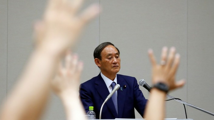 Yoshihide Suga, Japan's Chief Cabinet Secretary attends a news conference, in Tokyo