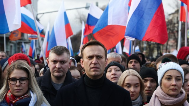 MOSCOW, RUSSIA - FEBRUARY 29, 2020: Opposition activists Lyubov Sobol (L), and Alexei Navalny (C) with wife Yulia (R) t
