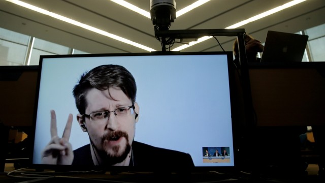 FILE PHOTO: Snowden speaks via video link as he takes part in a round table on the protection of whistleblowers at the Council of Europe in Strasbourg