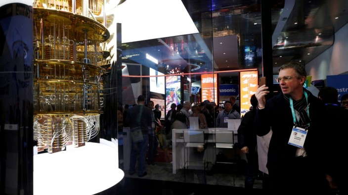 FILE PHOTO: A man takes a photo of a model of the IBM Q System One quantum computer during the 2020 CES in Las Vegas