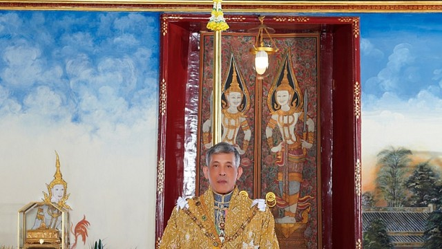 Thailand's King Maha Vajiralongkorn and General Sineenat Wongvajirapakdi, the royal noble consort are seen in this undated handout photo obtained by Reuters