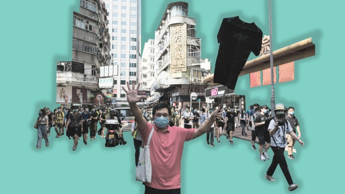 September 6, 2020, Hong Kong, China: A man gestures and holds a black shirt during an unauthorized rally in Hong Kong. T