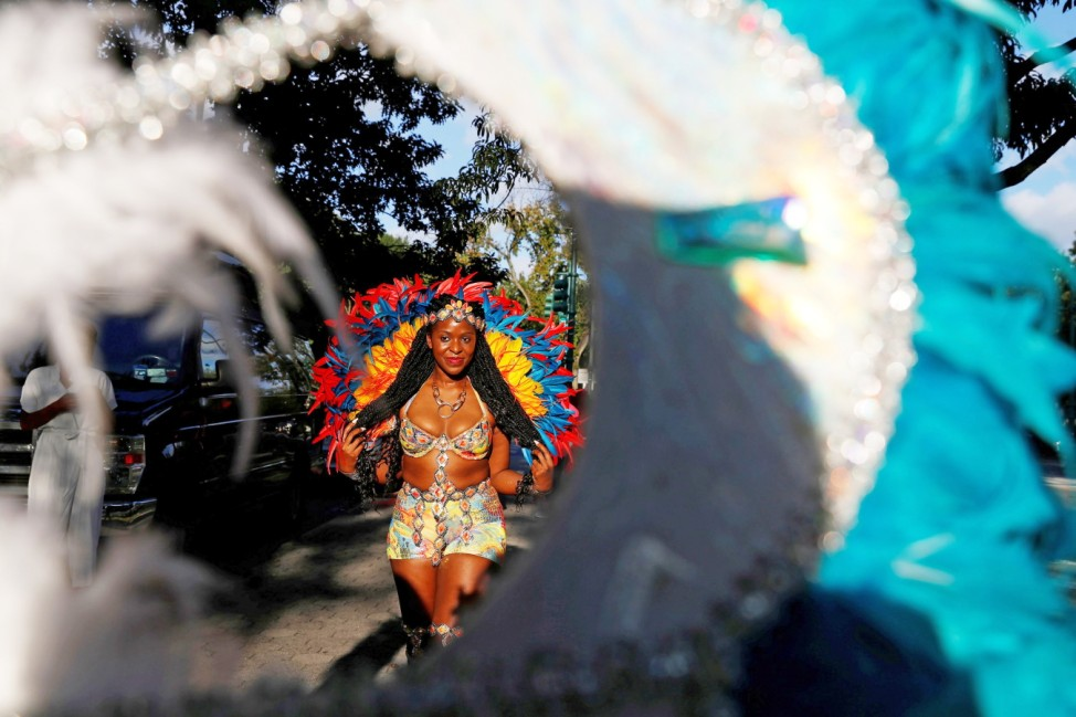 A model for the virtual 2020 West Indian American Day Parade walks before the live-streamed event in the Brooklyn borough of New York