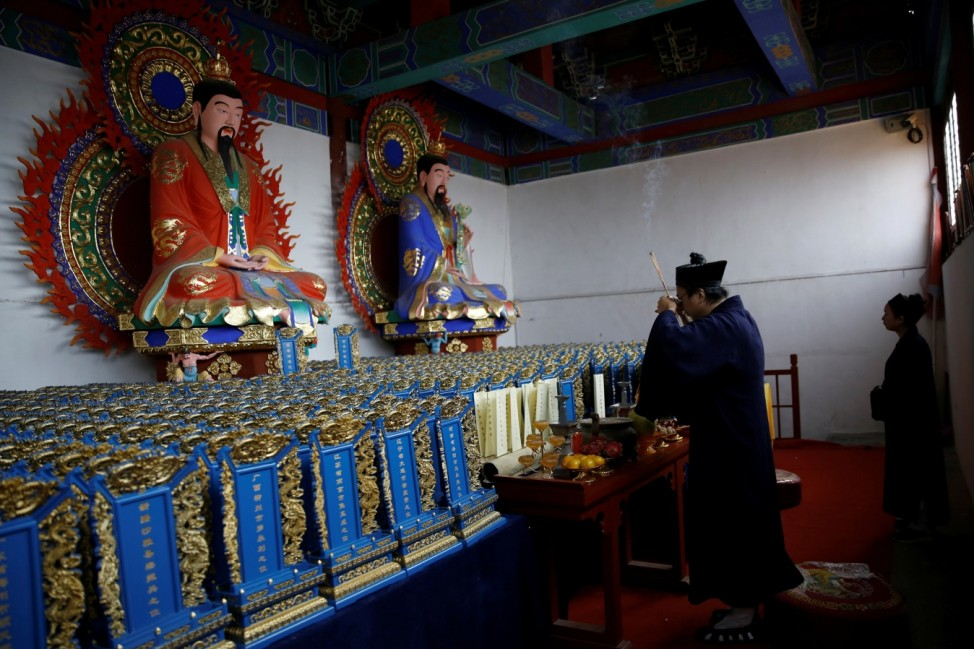 The Wider Image: Taoist priest honours China's coronavirus dead with memorial tablets