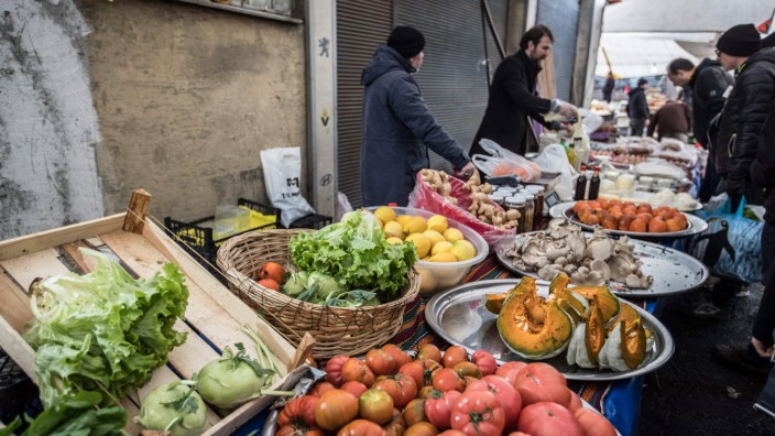 January 13 2019 Istanbul Turkey Vendor sells vegetables in the organic market in Kasimpasa Is