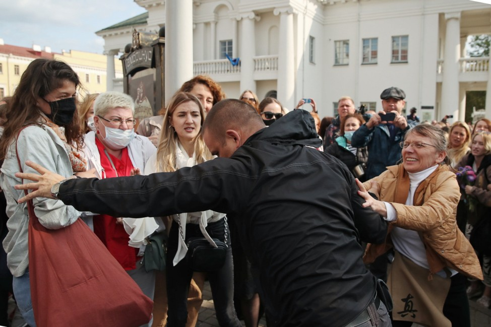 MINSK, BELARUS - SEPTEMBER 12, 2020: Protesters scuffle with a plain clothes law enforcement officer at Svobody Indepen
