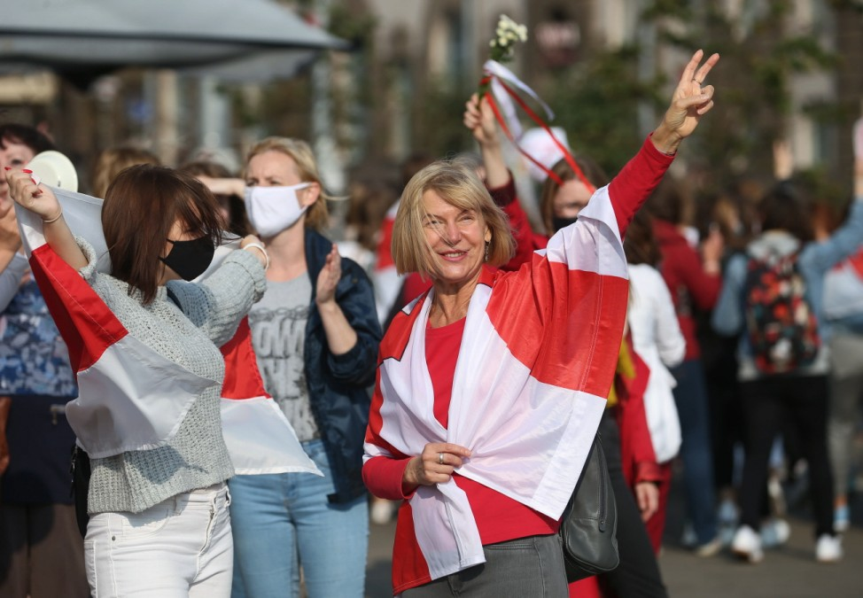 MINSK, BELARUS - SEPTEMBER 12, 2020: Protesters with red and white flags take part in Women s March in support of oppos