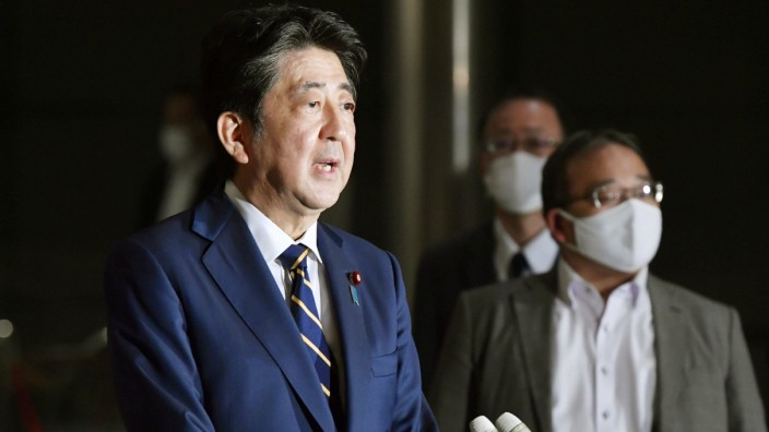 Japan PM Abe on missile defense plan Japanese Prime Minister Shinzo Abe speaks to reporters in Tokyo on Sept. 11, 2020.