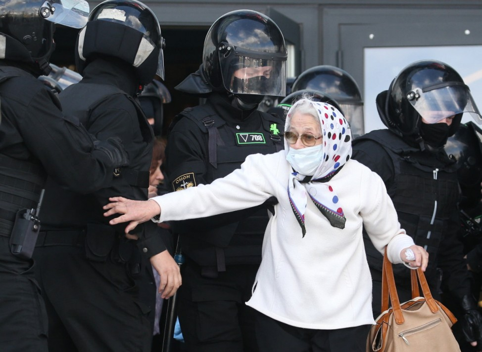 MINSK, BELARUS - SEPTEMBER 13, 2020: Law enforcement officers detain a woman during the March of Heroes opposition even