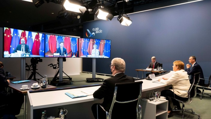 A government handout shows German Chancellor Merkel during a video conference with European Council President Michel, European Commission President von der Leyen and China's President Xi Jinping at the Chancellery in Berlin