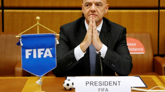 FIFA President Infantino waits for a signing ceremony in Vienna