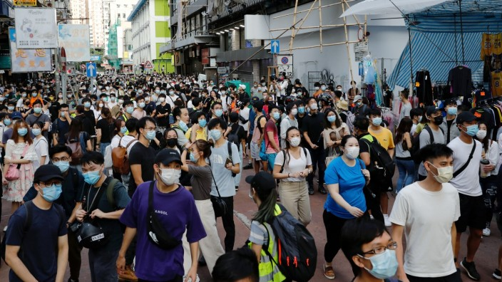 People gather during a demonstration opposing postponed elections, in Hong Kong