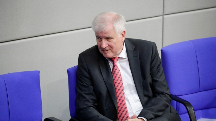 Interior Minister Horst Seehofer attends a session of Bundestag, in Berlin