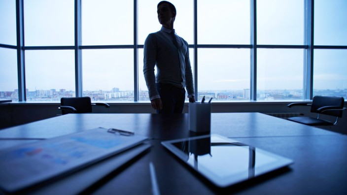 Business documents and touchpad at workplace on background of man by the window model released Symb