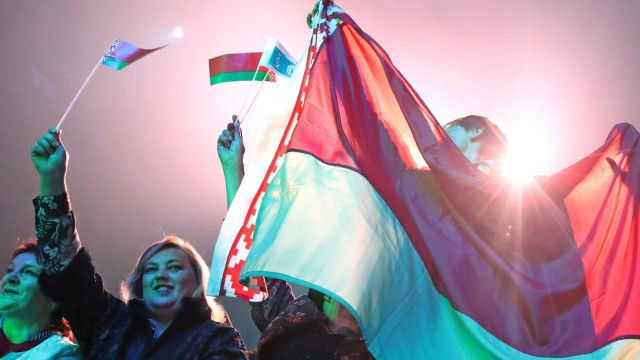 MINSK, BELARUS - SEPTEMBER 17, 2020: Members of the Belarusian Union of Women wave Belarusian flags during a concert at