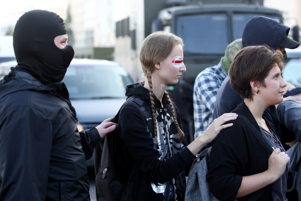 TOPSHOT - Women are arrested by Police on September 20, 2020 in Minsk during a demonstration called by opposition movement for an end to the regime of authoritarian leader Alexander Lukashenko. - Belarusian authorities brought today military trucks and barbed wire into central Minsk ahead of a planned opposition march, a day after police detained hundreds of women demonstrators. (Photo by - / TUT.BY / AFP)