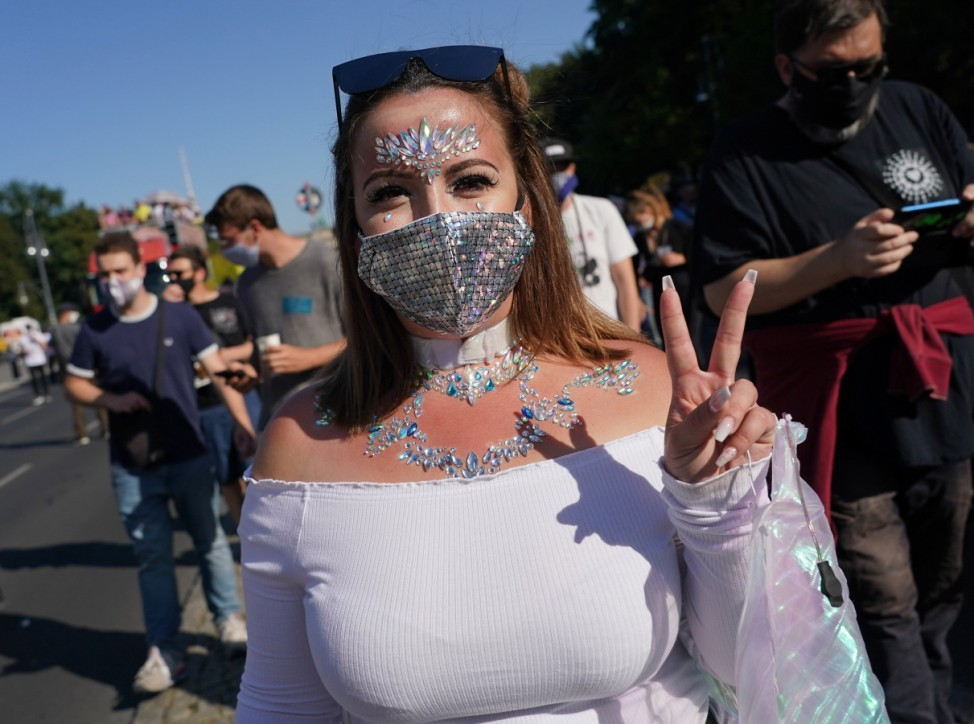 Clubbing Enthusiasts Dance In The 'Love World Peace Parade' During The Coronavirus Pandemic