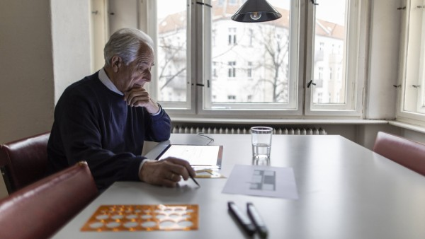 Senior man using tablet with architectural plan model released Symbolfoto property released PUBLICAT