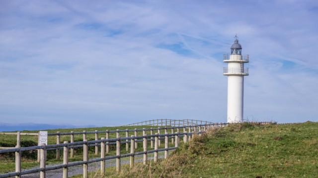Faro de Cabo Ajo - lighthouse on a cape near Ajo town on the Atlantic Ocean coast in Cantabria region of Spain. (Konrad Zelazowski)