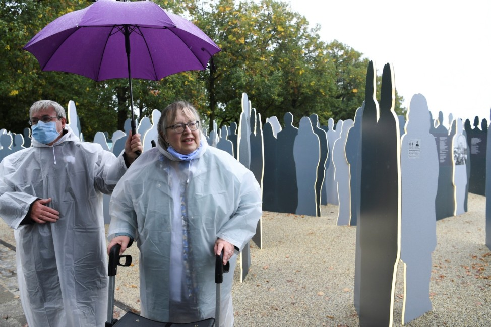 Renate Martinez, survivor of the 1980 Oktoberfest bombing, stands in front of the new memorial at Theresienwiese in Munich