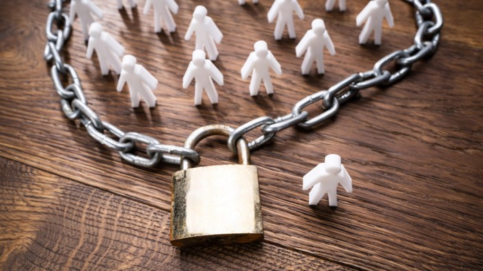 Person Figures Surrounded By Chain And Lock Copyright: xAndreyPopovx Panthermedia27953785