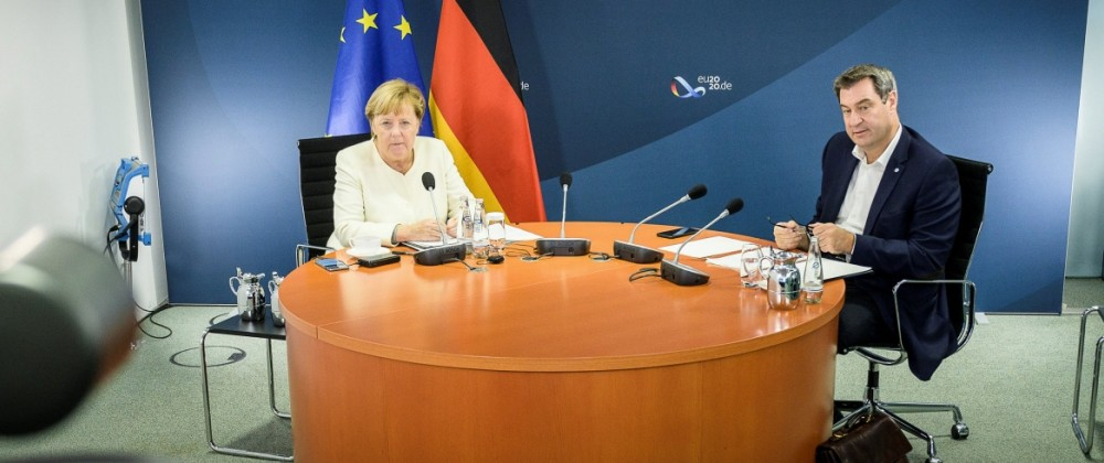 German Chancellor Angela Merkel and Bavarian federal Prime Minister Markus Soeder are seen in a video conferencing room in Berlin