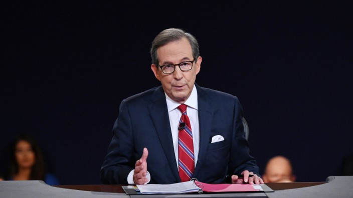 Debate moderator and Fox News anchor Chris Wallace directs the first presidential debate between Democratic presidentia