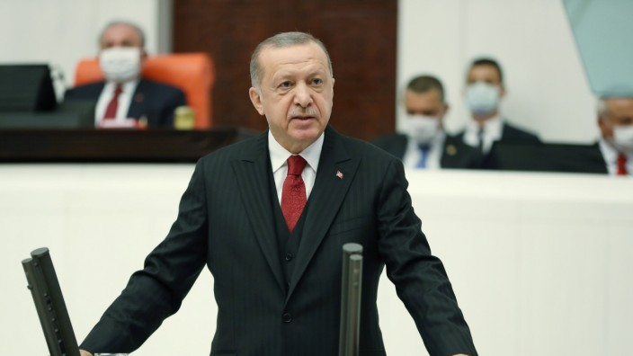 Turkish President Erdogan makes a speech during the reopening of the parliament in Ankara
