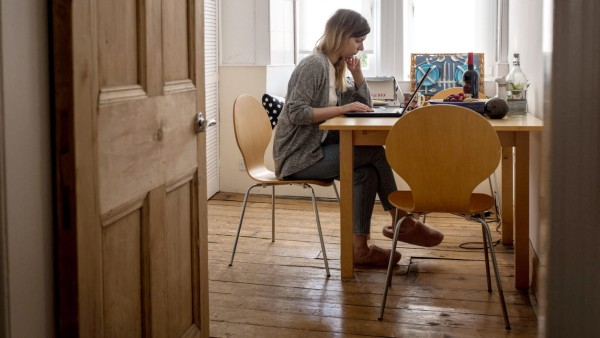 A woman keeps working from home