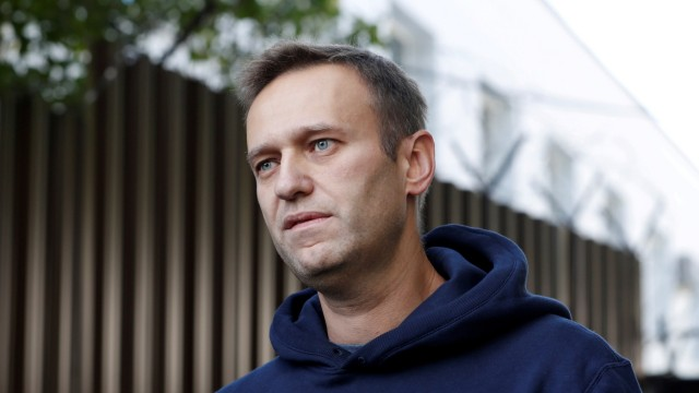 FILE PHOTO: Russian opposition leader Navalny speaks with journalists outside a detention centre in Moscow