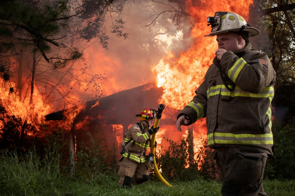 Firefighters respond to a house fire in the aftermath of Hurricane Delta in Lafayette, Louisiana